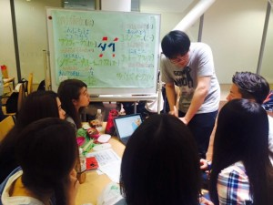 Students learning another language from a fellow international student.