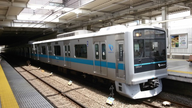 A silver and blue commuter train in Japan.