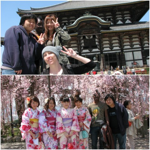 Justin posing with friends in front of a temple and cherry blossom trees.