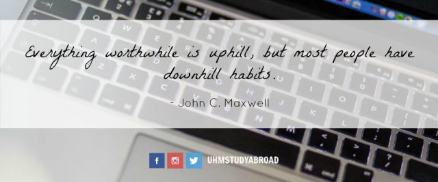 Image of a computer keyboard with a quote by John C. Maxwell: Everything worthwhile is uphill, but most people have downhill habits.