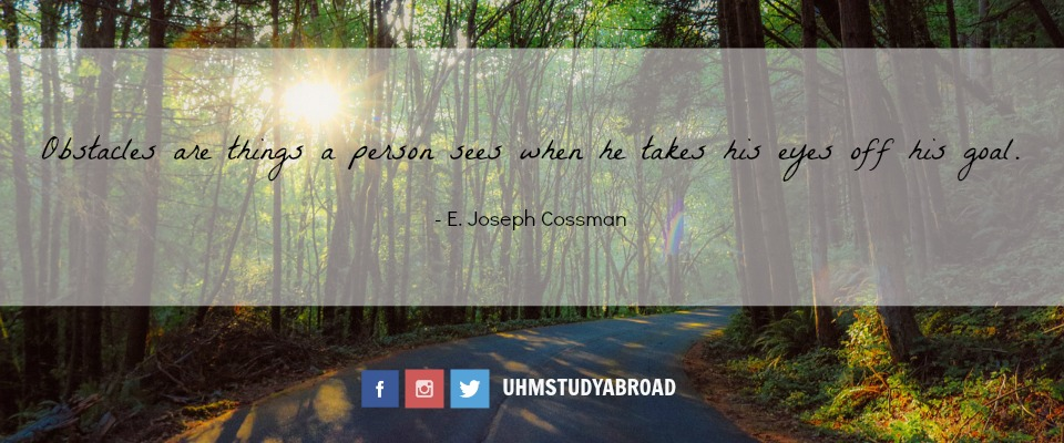 Photograph of a forest path with the quote by E. Joseph Cassman: Obstacles are things a person sees when he takes his eyes off his goal.
